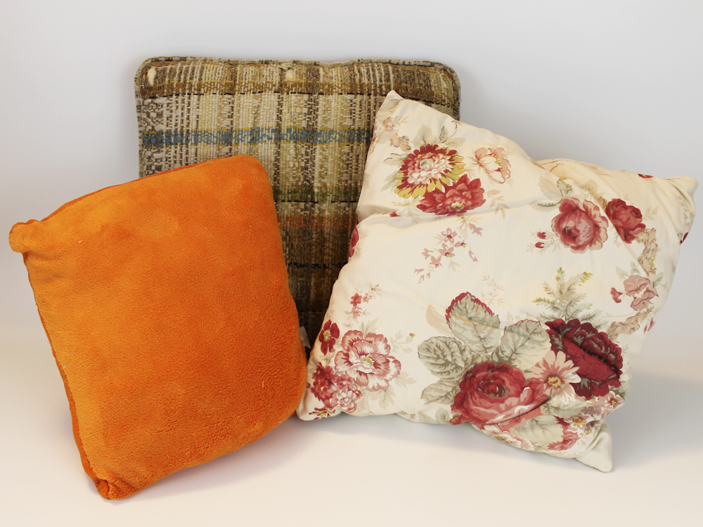 Easily create an inexpensive custom pillow cover in 10 minutes using fabric, felt and glue, that is both beautiful and unique using our free kit patterns.