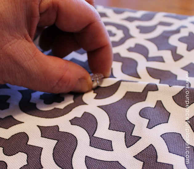 Upholstery pins are are an incredibly simple yet versatile tool for doing some quick no-sew recovering in your home. We recovered a window seat in minutes!