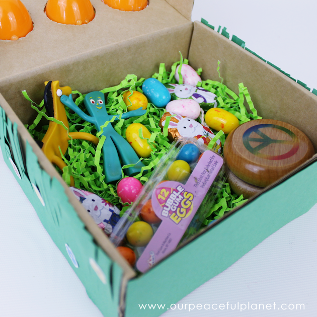 Make this cute carrot garden diy Easter basket using plastic eggs, a box and some construction paper! You can fill the box and the carrot eggs with goodies.