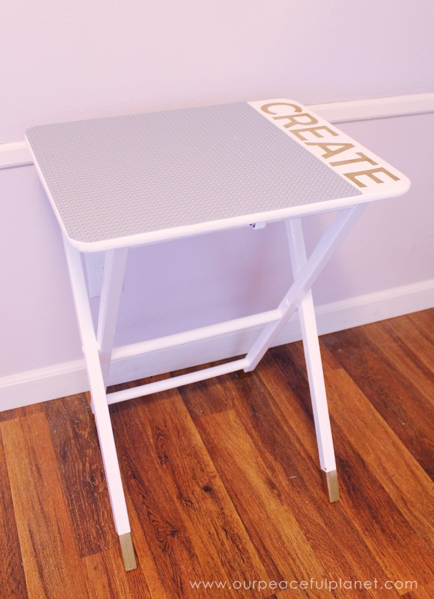 Love Lego? Make this easy portable DIY Lego table from an old TV stand. You can even have it match your decor. A Lego mat, paint, glue and stencils. Voila!