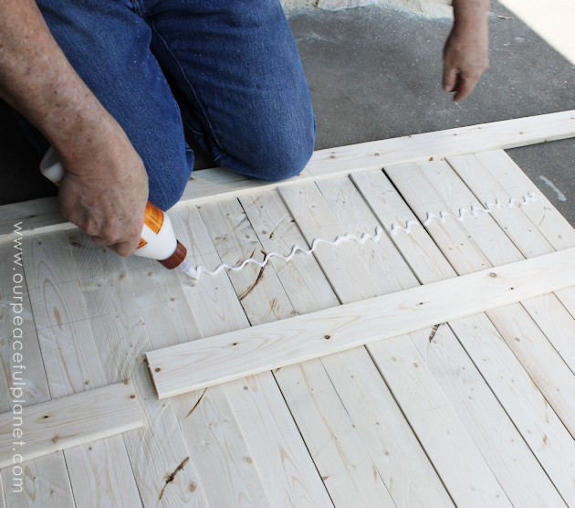 Add some whimsy to your home with this easy DIY picket fence fireplace cover. Made with wood slats and some hinges you can decorate it for any season.