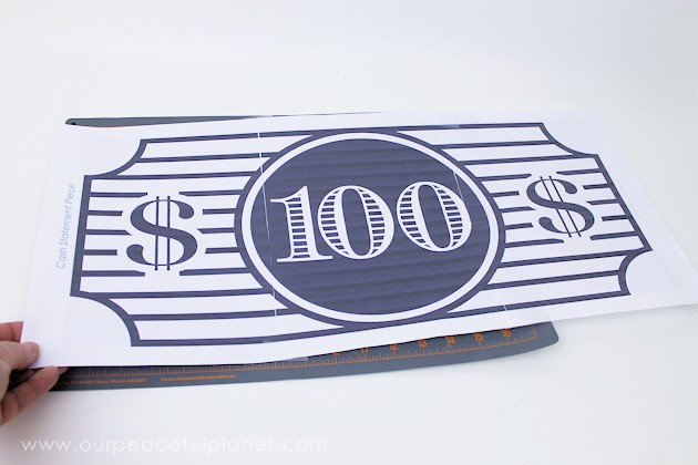 We made this classy $100 bill statement piece out of a piece of foam board used as packing in something we ordered. Cost? $0 (You can also buy foam cheap!)