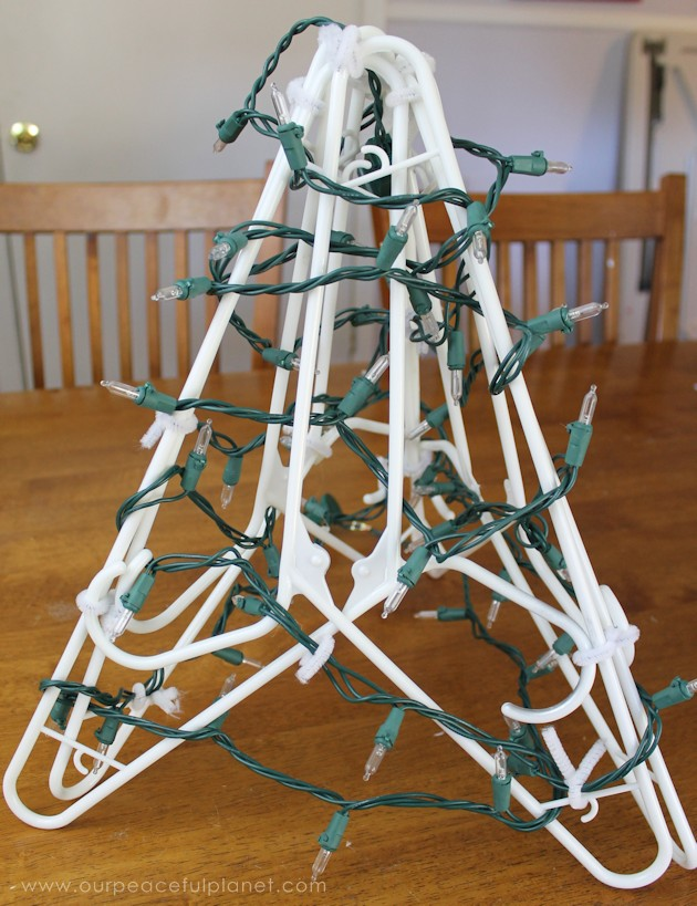 We'll show you how to make the prettiest little rustic upcycled burlap Christmas tree you've ever seen using six hangers. Add bells & a star to complete it.