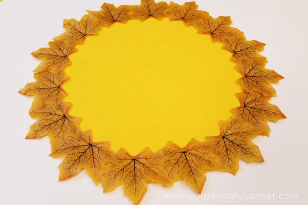 These quick autumn placemats were made from a piece of felt and fall leaves purchased at the dollar store. They turned a fall table into something elegant!