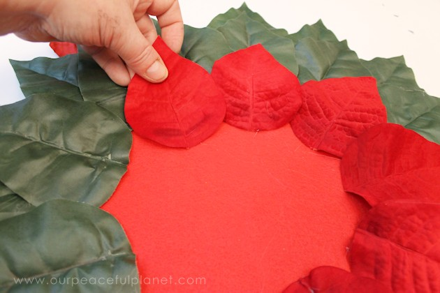 Make these elegant poinsettia Christmas placemats using a large piece of felt, some artificial poinsettias and hot glue. They also make a great centerpiece!