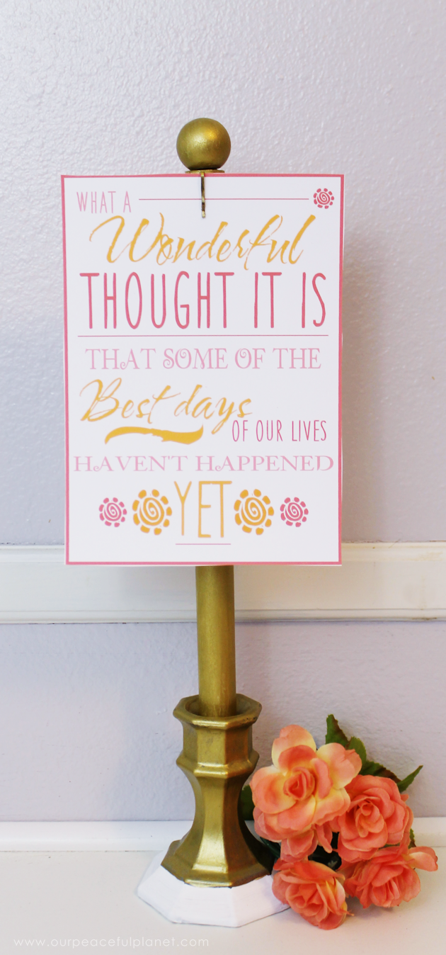 This classy display clip stand is made from a candle holder, dowel and bobby pin and it can not only display he free printable motivational quotes below but photos and more!