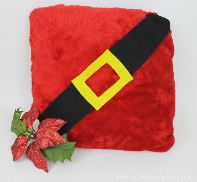 With two Dollar store Santa hats, you can make the cutest two-sided Santa pillow ever! Keep it or give them away as neighbor gifts! Free fun printable tags.
