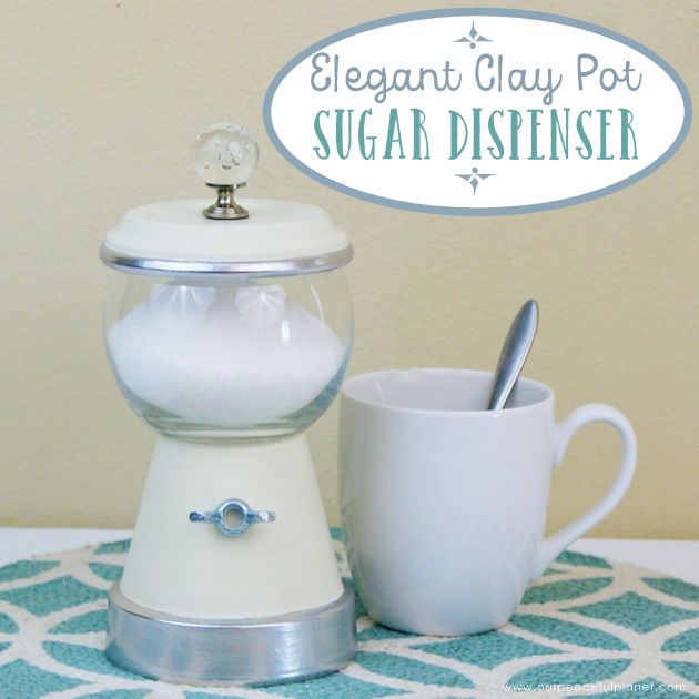 This elegant DIY sugar dispenser will add some beauty to your kitchen. It's made from a clay pot and a glass bowl and is inexpensive and simple to create!