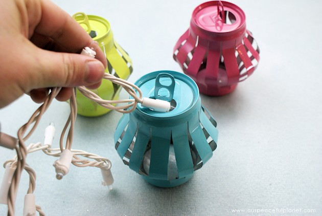 Learn how to make Chinese lanterns that you can string inside or outside your home for parties or events. They are wonderful upcycles made from soda cans!