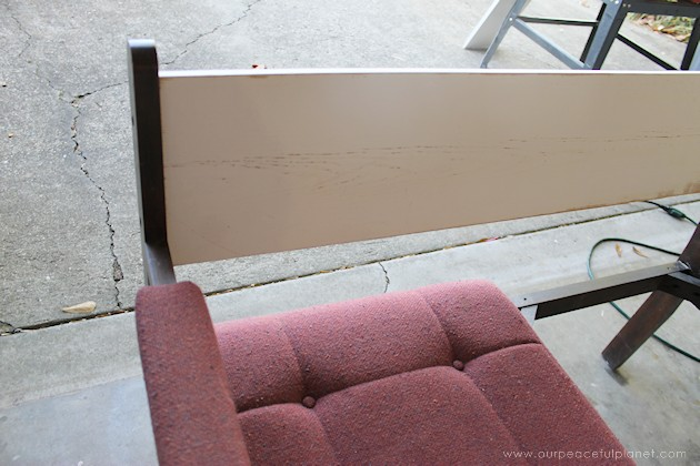 Watch how two $2 thrift store office chairs were transformed into a gorgeous comfy bench seat with nothing more than some paint and $6.00 of material.