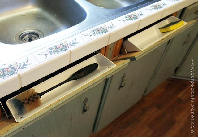 get rid of sink clutter and utilize wasted space by instlaling tip out hidden trays in blank11. Interior Design Ideas. Home Design Ideas