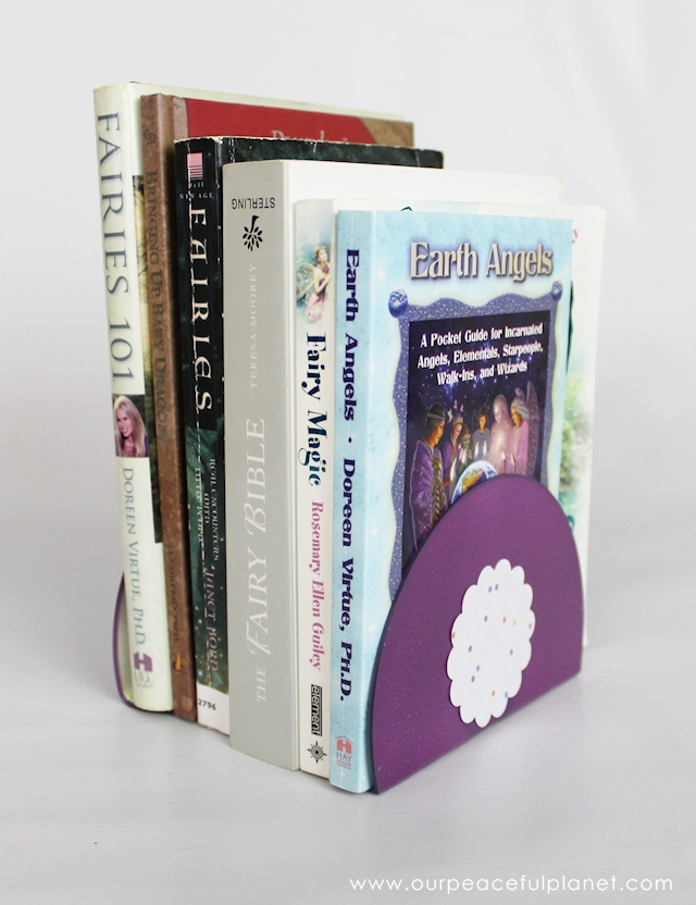 These DIY Bookends take 5 minutes to make and cost nothing! You can decorate them however you like. All you need is some blank CDs or DVDs and a candle. They work great for small to medium books.