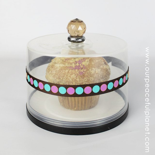 This darling little treat holder is an upcycle made from those disc spools that your blank 50 count CDs or DVDs come in. It's perfect for a few cookies, or a large muffin as shown. Any small knob works for the top. You could even glue a large wood wall onto it! What a unique way to give a treat to someone special.