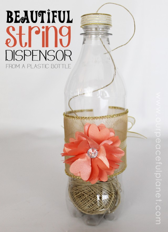 What a great way to keep string handy and easy to use! This is a plastic soda bottle with some ribbon and extras glued on. You could make several to organize various types of string or even small ribbons! Useful upcycles rock!