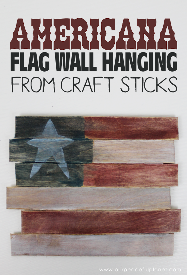 This rustic Americana decor flag can be hung year round and it's so easy for anyone to make! All you need are some large craft sticks, glue and paint.