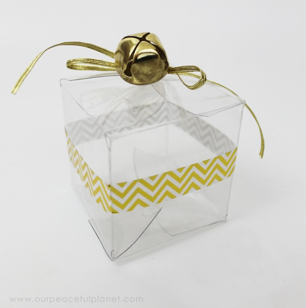 These upcycled plastic soda bottles make unique Christmas gift wrapping ideas and are perfect for our healthy chocolate fudge recipe as a neighbor gift!