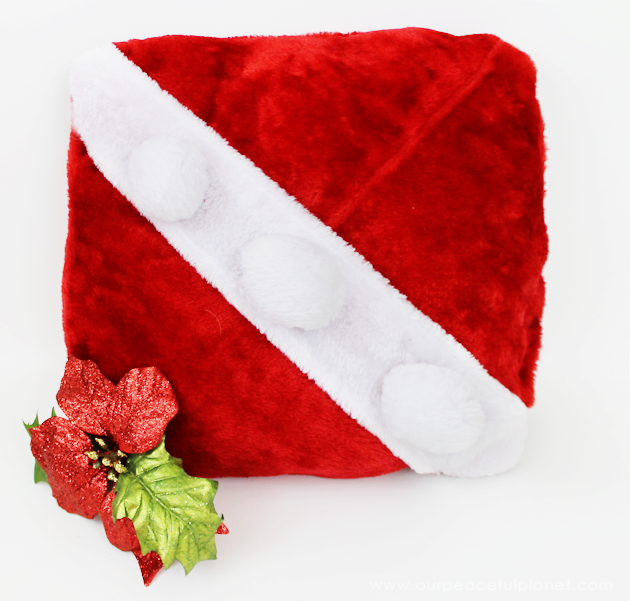 With four Dollar store Santa hats, you can make the cutest two-sided Santa pillow ever! Keep it or give them away as neighbor gifts! Free fun printable tags.