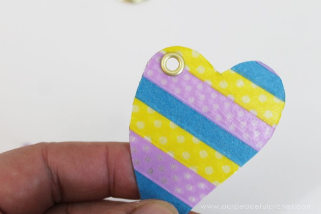 Make a heart keyring as a gift for Valentine's Day or any day! This upcycle uses a plastic lid, a split key ring & some fabric or Washi tape & Mod Podge!