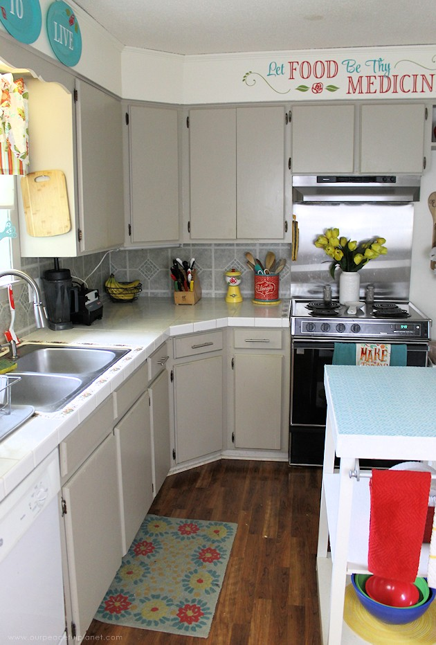 See the final reveal of our outdated kitchen transformation, completed with a minimum of cash. It's now a fun, inspiring place to be. Before & after photos!
