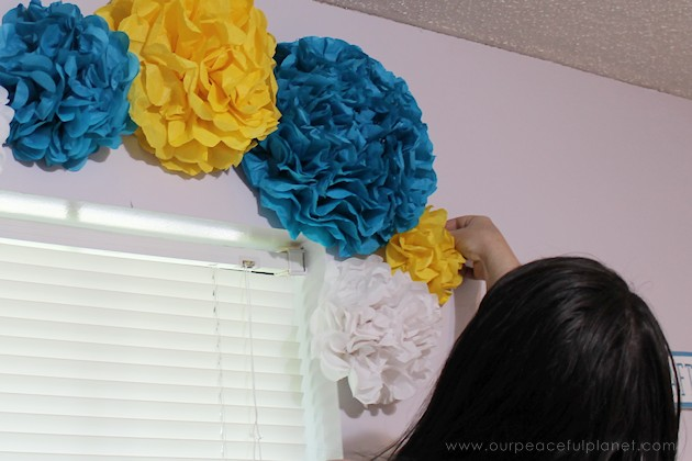 For simple & unique window treatment ideas you'll love our tissue paper flower window toppers. The gorgeous flowers cost pennies & take minutes to make.