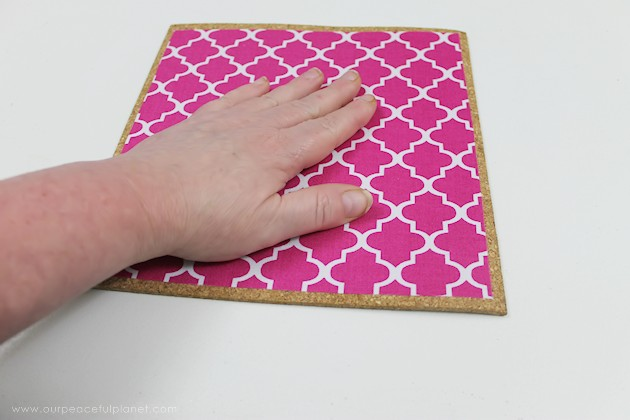 Learn how to make a custom DIY mouse pad in 10 minutes with cork, a bit of material & some spray adhesive. So easy & inexpensive you can make a whole set!