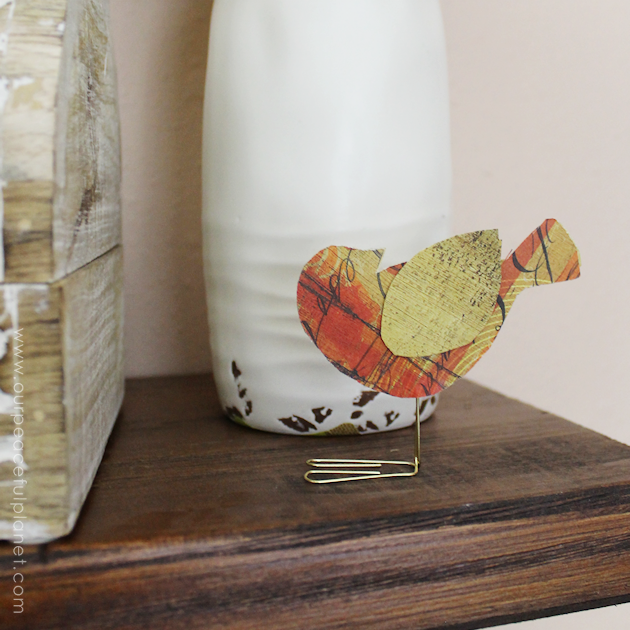 These sweet little birdies are perfect for a touch of whimsy DIY room decor and they can be placed in any room you like! Sit them on shelves, mantles, on top of books... you can even put a row on top of a door jam! Using our pattern you can make whatever colors you like. All you need is the paper of your choice and two paperclips and glue.