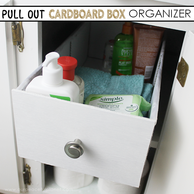 Learn how to make an inexpensive pull out cabinet organizer using a cardboard box so you can easily access things in the far reaches of your lower cabinets.